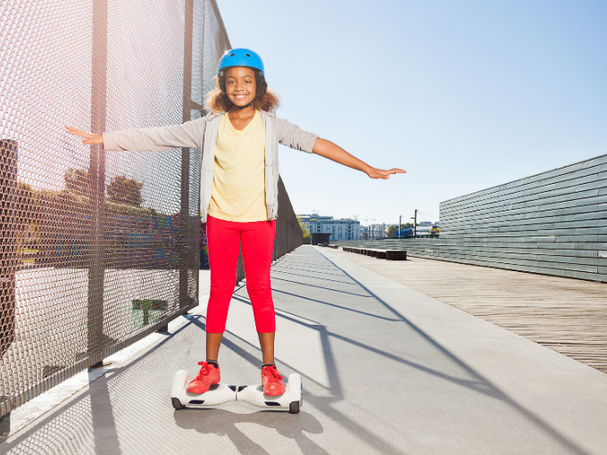 A child riding one of the best hoverboards for kids